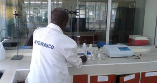 A technician tests water at Nyeri Water and Sanitation Company's laboratory.